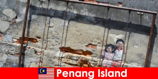 El fascinante y diverso arte callejero en la isla de Penang asombra a extraños