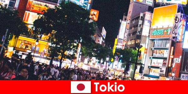 Tokio para vacacionistas en la ciudad de luces de neón parpadeantes la vida nocturna perfecta